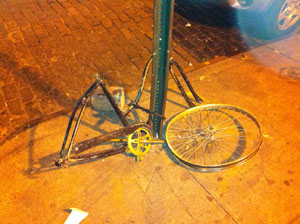 Well, I guess there are less advantageous ways to get around than by car. This sorry cycle was found in Manhattan's Little Italy one unfortunate Saturday night in November 2011.