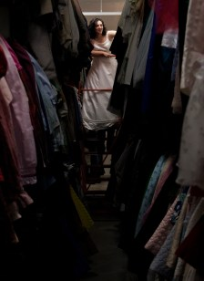 Susan Barber searches the costume closet at Missoula Children's Theater for a wedding dress.