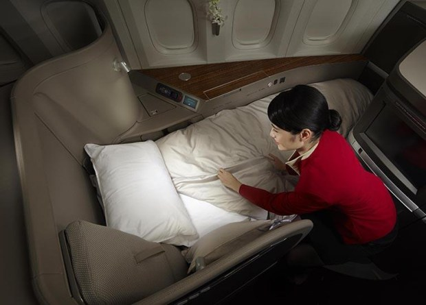 Flight attendant preparing my bed