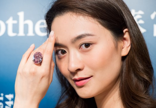 HONG KONG, CHINA - MARCH 29:,A model shows the 59.60 carat Pink Star diamond, expected to fetch US$60 million plus, to the press at Sotheby's Hong Kong, Hong Kong SAR, China on March 29, 2017. The Pink Star Diamond goes on auction with Sotheby's Hong Kong.
