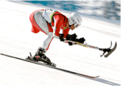 Photograph of Paralympic ski racer with adaptive poles.