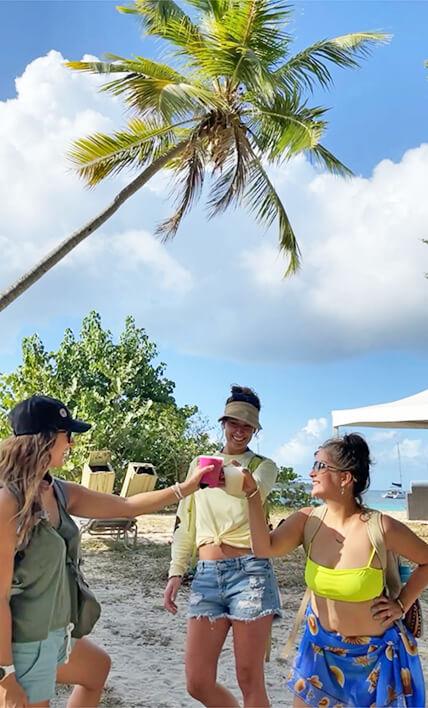 3 Girls toasting on a beach