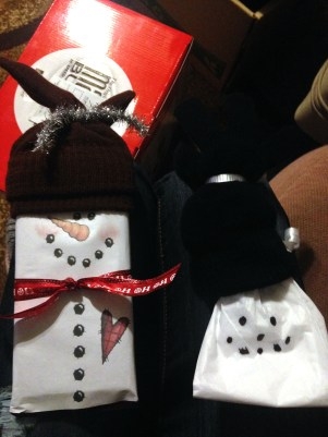 Candy snowmans made by friend (left) and nephew (right).