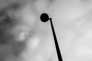 Light Pole Against Clouds