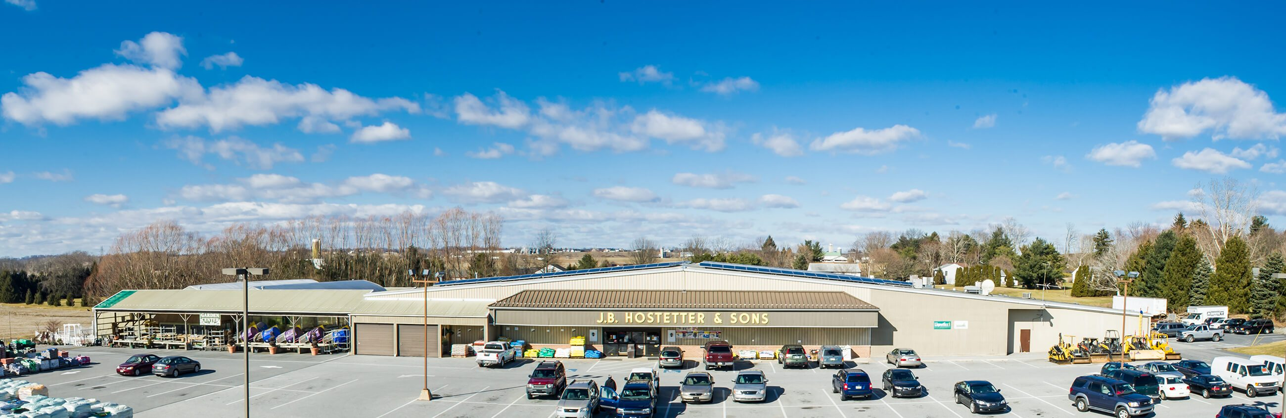 JB Hostetter store front and parking lot