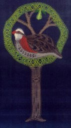 Partridge in a 12-Pair Tree Designed using 12 pairs of bobbins for The Lace Guild calendar, but the design was subsequently published in their magazine