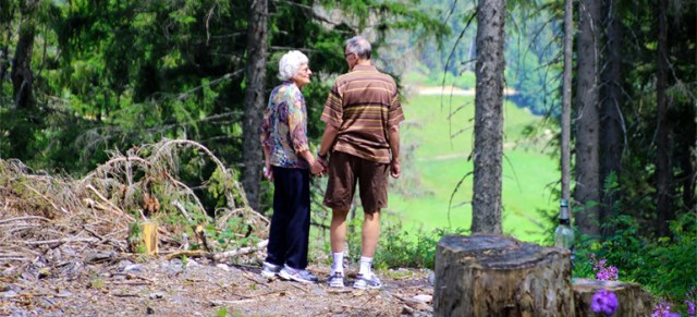 Two seniors walking in nature