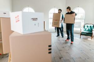 Movers movign around boxes