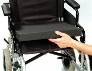 wheelchair cushion being placed on a chair