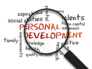 Magnified Personal Development word illustration on white background.