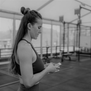 woman looking custom workout on phone