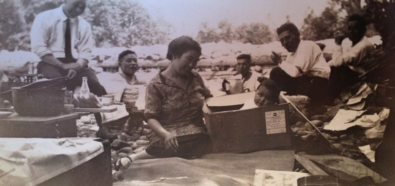 Issei picnic on the beach with Matsu Uyeda and baby Uyeda in a box.  Circa 1940 Vancouver, BC.