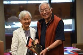 Mary Kitagawa presents book to Ray Iwasaki