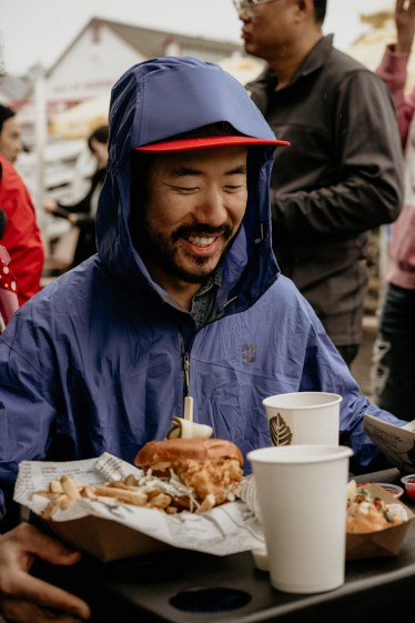 Derek Sakauye, visiting from Toronto, enjoys a plate of fish and chips in Steveston during lunch on Monday, May 20.
