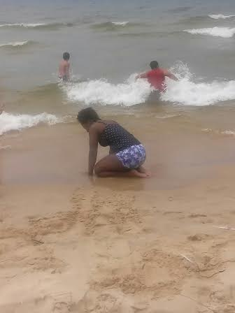 """Ajhane Foster at Lake Michigan """"I stopped here with my family on the way to Michigan Adventures, the beach is my favorite place to be,"""" Foster said."""