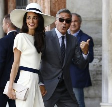 US actor George Clooney and British lawyer Amal Alamuddin arrive on September 29, 2014 at the palazzo Ca Farsetti in Venice, for a civil ceremony to officialise their wedding. AFP PHOTO / PIERRE TEYSSOT (Photo credit should read PIERRE TEYSSOT/AFP/Getty Images)