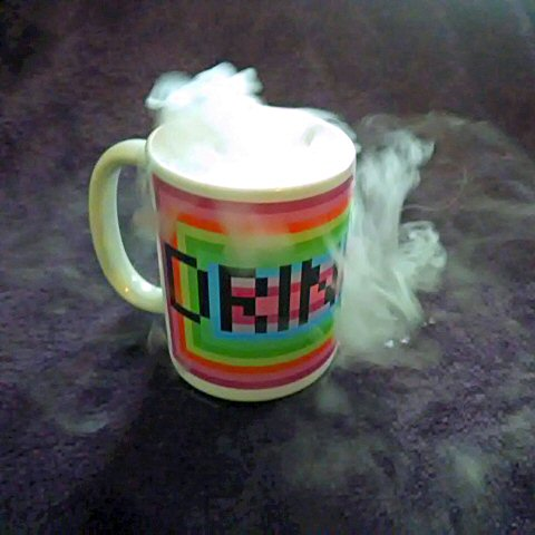 Picture of Drinking Mug, with Carbon Dioxide spilling from the top.