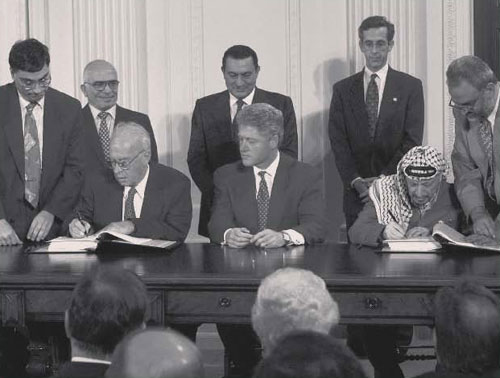 President Bill Clinton, Israeli Prime Minister Yitzhak Rabin, and PLO leader Yasser Arafat sign the Oslo II Interim Agreement, September 28, 1995, at the White House. (AP Photo/Doug Mills) - Israel's Rights Regarding Territories and the Settlements in the Eyes of the International Community