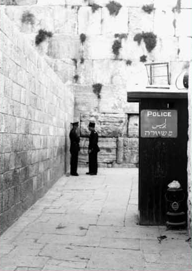 The narrow Western Wall alley, 1933. The Jews fought for their right to pray at the Western Wall of the Temple Mount compound. The libel accused them of seeking to topple the Temple Mount mosques. (Zoltan Kluger, Government Press Office)