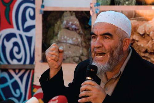 "Sheikh Raed Salah, head of the northern branch of the Israeli Islamic Movement. He became the successor of Haj Amin al-Husseini, refurbished the ""Al-Aksa is in danger"" libel, incited violence, and promised to redeem Al-Aksa ""in fire and blood."" (Tara Todras-Whitehill, Associated Press)"