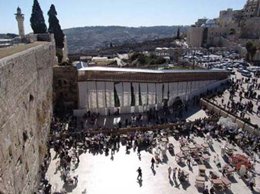 The temporary wooden bridge that Israel built to replace the collapsed ramp. It is not used by Muslim worshippers, who have many other entrances to the Temple Mount. The Mughrabi Gate is the sole entrance to the Temple Mount for Jews, tourists, and Israeli security forces since the Six-Day War. (Western Wall Heritage Foundation)
