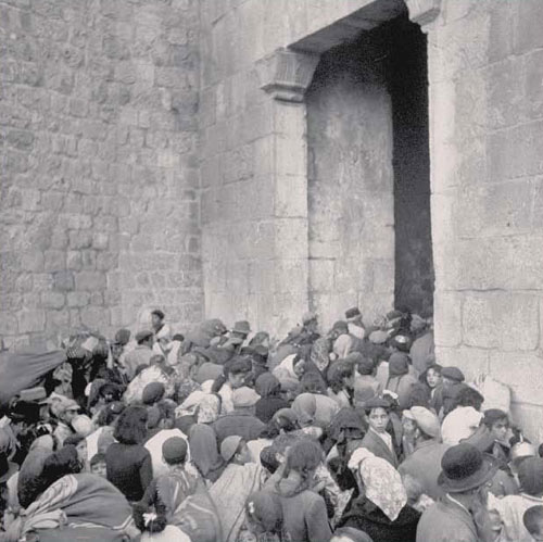 Jewish refugees stream out of the Old City of Jerusalem in 1948 escaping the invading Arab Legion. (Phillip John, Getty Images, 1948) - Defending Israel's Legal Rights to Jerusalem