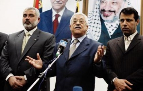 From a previous era: Mahmoud Abbas flanked by Hamas' Ismail Haniyeh (left) and Mohammed Dahlan