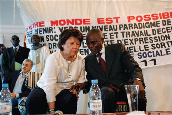 Martine Aubry, left, first secretary of the French Socialist Party, confers with Senegalese Socialist Party leader Ousmane Tanor Dieng during a World Social Forum event at Place du Souvenir in Dakar, Senegal, on February 9, 2011. The World Social Forum (WSF) is an international antiglobalist gathering that has provided an important platform for BDS promotion and cooperation among radical-left groups.