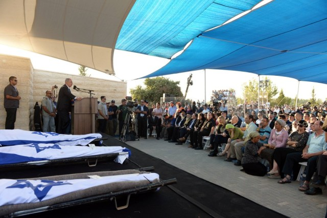 Prime Minister Benjamin Netanyahu speaks at the funeral of Eyal Yifrach, Naftali Fraenkel, and Gilad Shaar on July 1, 2014. The three boys were abducted and murdered by Hamas terrorists in the West Bank on June 12. (PMO/Flickr)