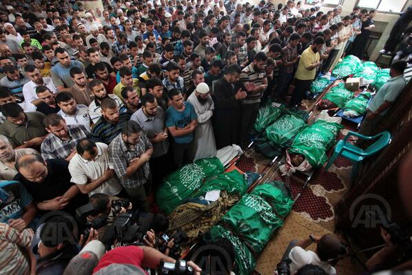 The Al Batsh family funeral on July 13, 2014. The men were wrapped in Hamas flags. (Anadolu Images)