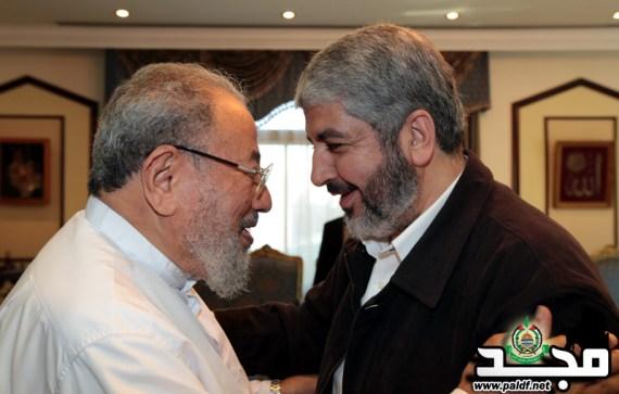 Qaradawi (left) greets Hamas leader Khaled Mashal