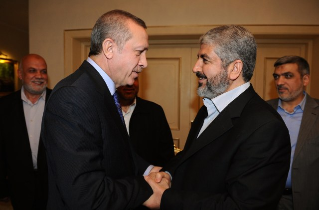 Turkish Prime Minister Recep Tayyip Erdogan (left) shakes hands with Hamas leader Khaled Mashal (right) during their meeting in Ankara on March 16, 2012. (AFP Photo/Yasin Bülbül)