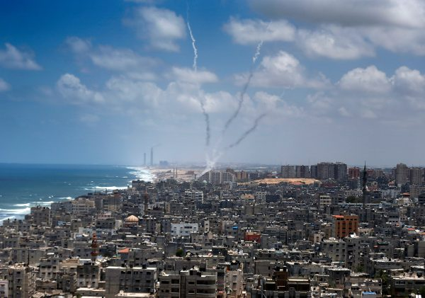 Hamas fires rockets from densely populated Gaza City into Israel on July 15, 2014. The power plant in the Israeli city of Ashkelon is visible in the background. (AFP/Thomas Coex)