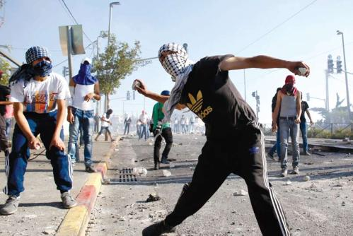 """Riots in Shuafat after the murder of the Palestinian teenage boy Muhammad Abu Khdeir, July 2014. During the """"Jerusalem Intifada"""" there were a few incidents of shooting from Shuafat at Pisgat Ze'ev. It was Israeli security control of the place that brought these to an end. In contrast, the shooting incidents from Beit Jalla at Gilo in the early 2000s went on for four years because the town had been transferred to the Palestinians. (Photograph: Sliman Khader, Flash 90)."""