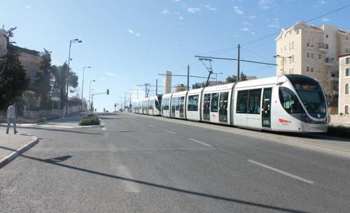 Over the years the city has also become interconnected by common infrastructure networks in the fields of transportation, water, electricity, sewage, and telephone services. The light rail, which has become a symbol of coexistence, serves Jewish and Arab neighborhoods. Here it moves along Road 1. (Photograph: Ariel Shragai)