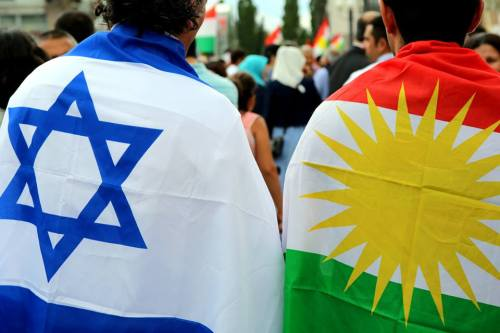 Kurdish and Israeli flags at a solidarity rally.