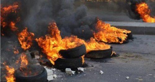 Burning tires in Nablus.