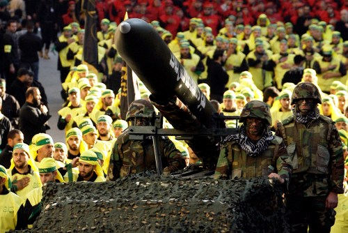 Hizbullah fighters with a Fajr 5 missile in southern Lebanon, 2012.