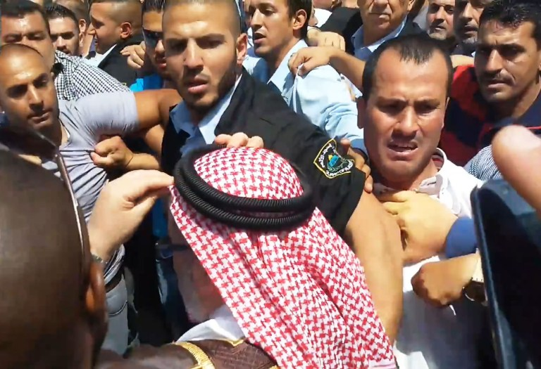 Mob attacking a Jordanian religious figure