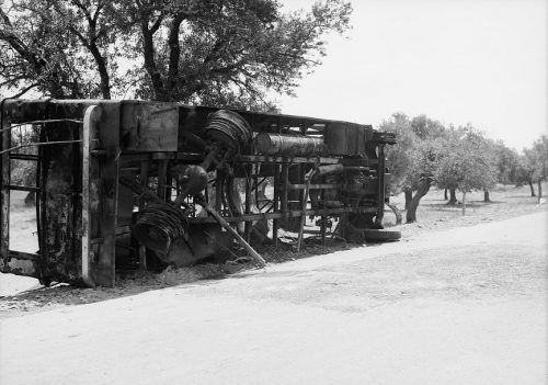 Remains of a burnt Jewish passenger bus