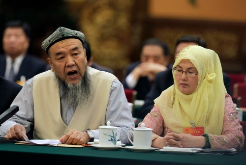 Muslim delegates from the Xinjiang Uyghur region