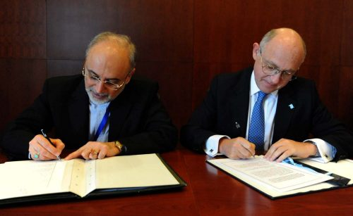 Iranian Minister of Foreign Affairs, Ali Akbar Salehi (left), and Argentinian Minister of Foreign Affairs, Héctor Timerman, signing the MOU in 2013.