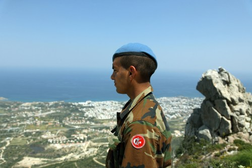 Turkish soldier overlooks Kyrenia (Girne) in Northern Cyprus