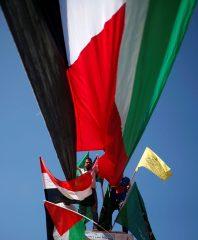Gazans waving flags of Fatah, Hamas, Palestine, and Egypt