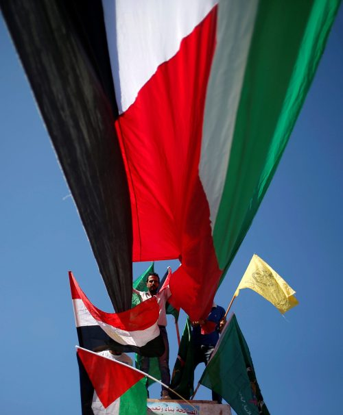 Gazans waving flags of Fatah, Hamas, Palestine, and Egypt