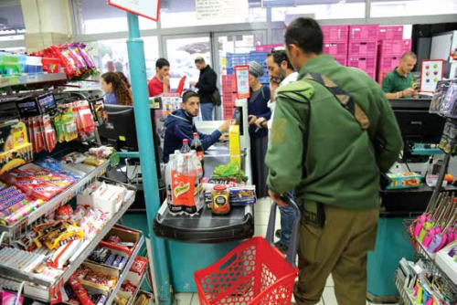Shoppers at the Rami Levy branch in Gush Etzion