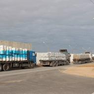 Trucks carry goods at the Kerem Shalom crossing