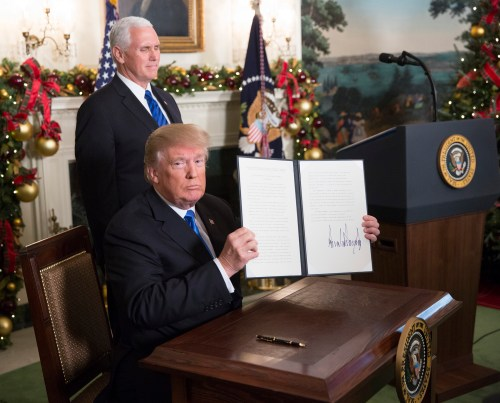 President Donald Trump shows a statement announcing intention to move the U.S. embassy in Israel to Jerusalem.