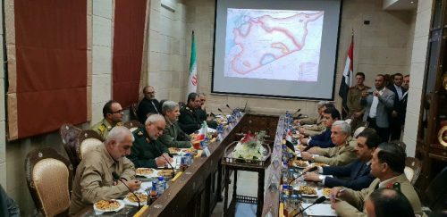 Iran's defense minister and a military delegation in a meeting with their Syrian counterparts