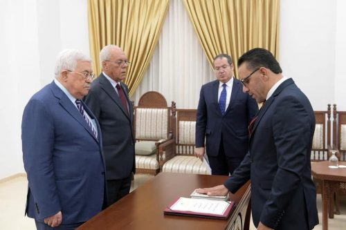 Gheith is sworn in as governor of Jerusalem by Mahmoud Abbas.